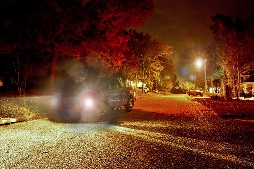 Photographic Simulation Of How Halos Might Appear Around Light Sources  During Night Driving In The Presence Of A Cataract.